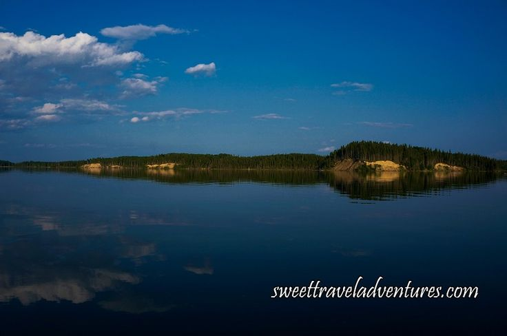 Trees and Sky Reflected on Crean Lake in Prince Albert National Park, Saskatchewan, Canada
