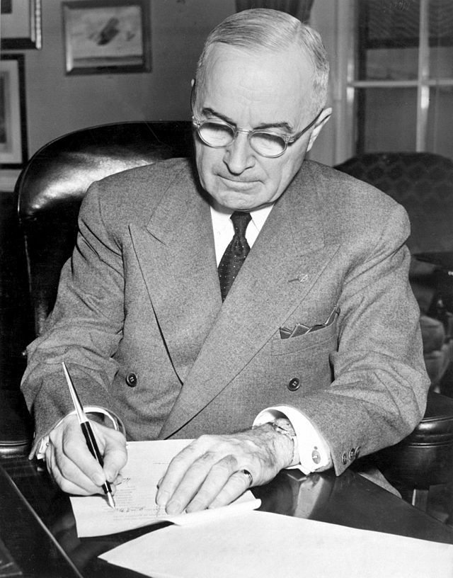 What relationship do Containment, the Marshall Plan, and NATO have to the Truman Doctrine?