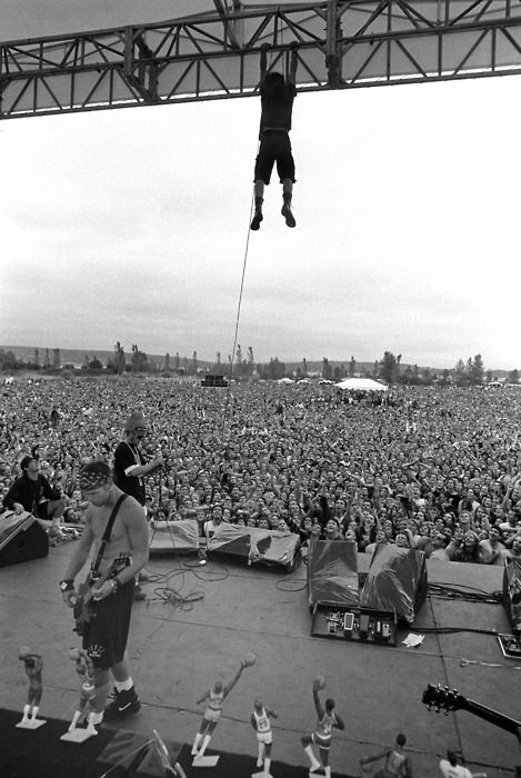 Eddie Vedder hanging off the stage.  probably the side-effects of a Vegan Vit B12 deficiency