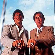 The quarterback-head coach combo of Jim Plunkett (left) and Tom Flores helped the Raiders win two Super Bowls. Jan. 22, 1984 — Raiders win World Championship of Professional Football for third time in eight years by defeating Washington Redskins, 38-9, in Super Bowl XVIII at Tampa Stadium in Tampa, Florida before crowd of 72,290 and a world-wide radio and television audience of over 125 million.