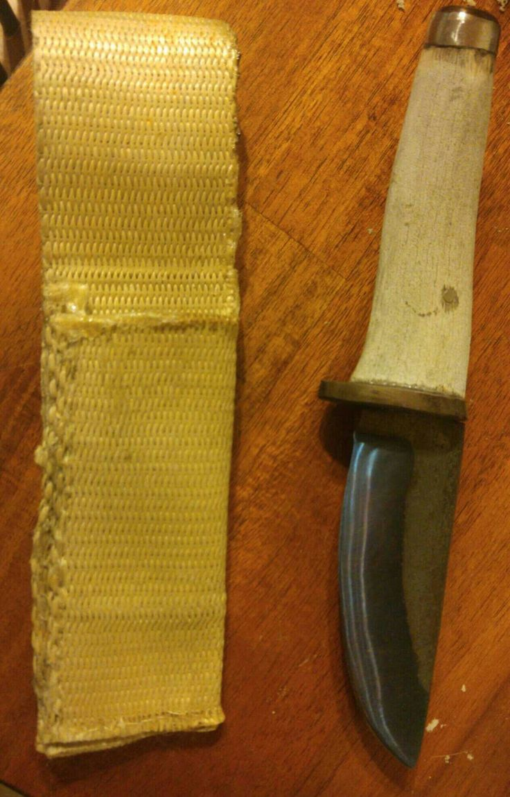 """4"""" spring steel skinning knife antler handle with steel gard and butt cap."""