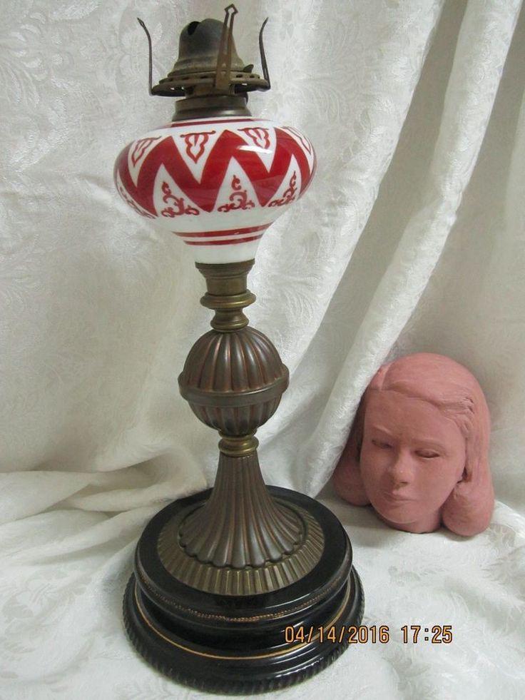ANTIQUE OIL LAMP RED/WHITE ZIG ZAG DSN FONT W/METAL COLUMN & PORCELAIN BASE