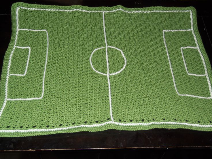 Made this blanket for a soccer themed baby gift. Blanket pattern is: Sweet Potato Baby Blanket by Erica Jackofsky (Fiddle Knits)  I surfaced crocheted the field lines on.