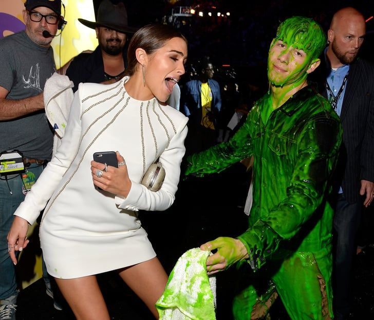 Pin for Later: 32 of the Cutest Celebrity Moments From 2015 When All Nick Jonas Wanted Was a Hug From His Girlfriend Just one of the many beautiful couple moments Nick Jonas and Olivia Culpo have shared.