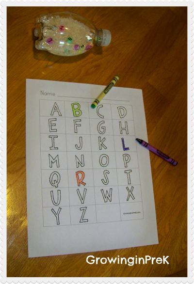I'm totally making this!  Put rice and ABC beads in a bottle, and the kids shake the bottle and color in the letters they see, until they've colored in all the letters.