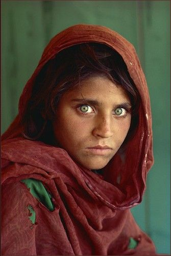 """Afghan Girl"" National Geographic June 1985 issue. Her name is Sharbat Gula, the photographer was Steve McCurry. In 2002 Sharbat was found, read this link to learn more about her : http://news.nationalgeographic.com/news/2002/03/0311_020312_sharbat.html"