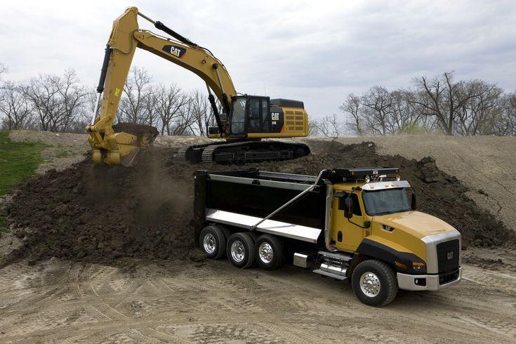 Cat 349e excavator and cat ct660 truck heavy machine