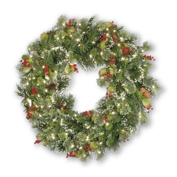 indoor outdoor wintry pine pre lit wreath has lushious greenery and is trimmed with pine cones snow flakes and red berries spare bulbs and fuses are - Lighted Outdoor Christmas Wreaths