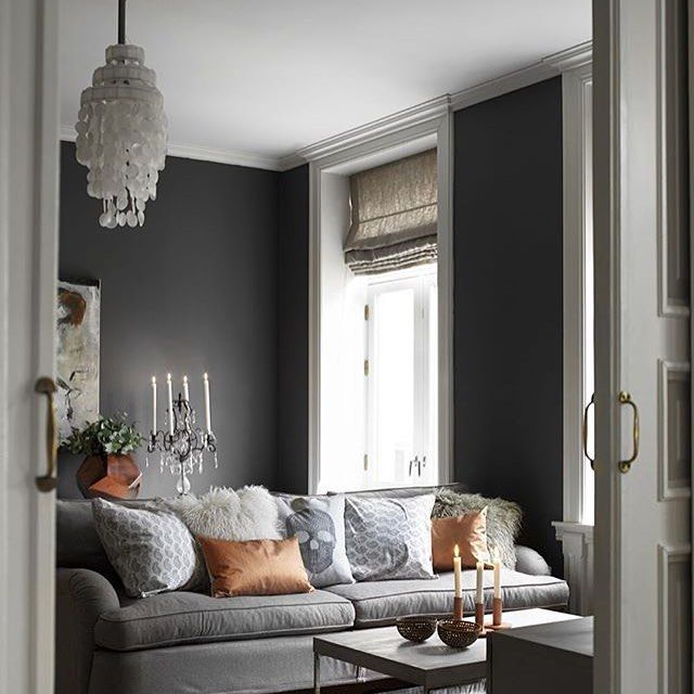 Gray Living Room With Copper Accents A Controlled Color Palette Makes Space Feel Serene