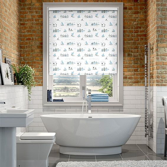 Oh we do like to be beside the seaside. This lovely, traditional roller blind depicts rows of quaint little boathouses with sailboats drifting on by.
