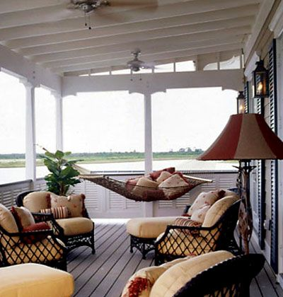 Fresh Air Oatmeal-colored spa-weave outdoor fabric and a bevy of ourdoor throw pillows cover wicker chairs and chaise lounges.