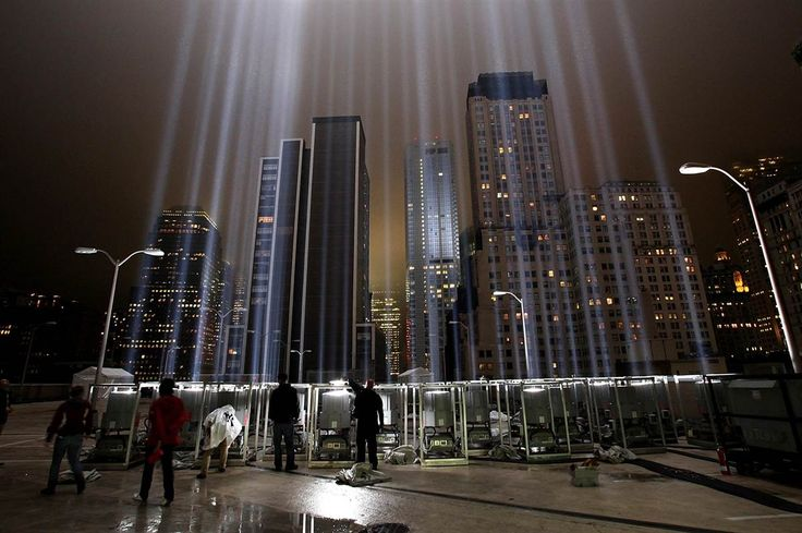 Workers adjust beams of the Tribute in Lights, Sept. 7, ahead of the 10th anniversary of the Sept. 11 terrorist attacks in New York City. The Tribute in Light is comprised of 88 searchlights that shine into the sky near the site of the World Trade Center.