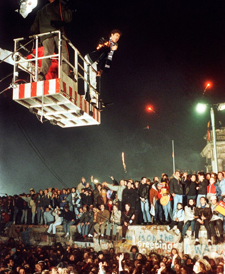 1989- David Hasslehoff singing over head as the Berlin Wall is being torn down. Hasslehoff an american Actor and singer supports the destruction of the wall.