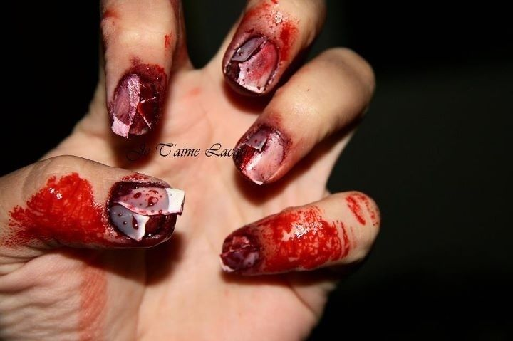 halloween creepiness using fake nails, red and purple lipstick, cotton and food coloring  (via ghost burger on reddit)