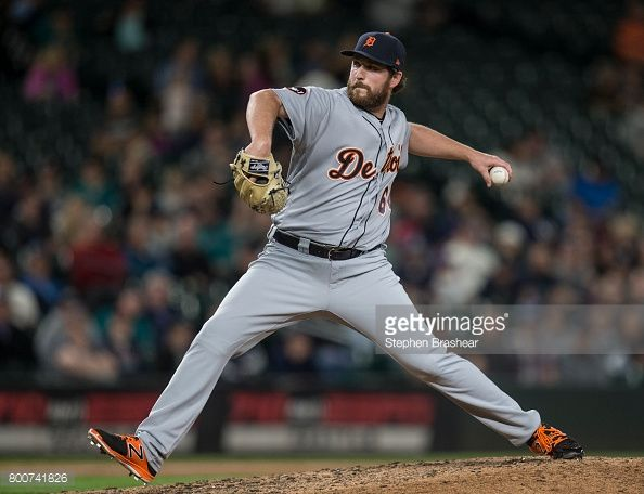News Photo : Reliever Chad Bell of the Detroit Tigers delivers...
