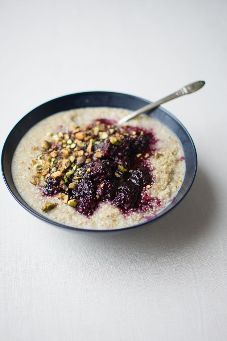 Tender, creamy sprouted quinoa porridge is dressed with a lightly sweetened blackberry sauce spiked with fragrant cardamom.