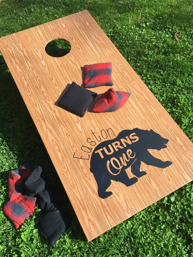 Used my Silhouette to recover Corn Hole Boards in contact paper to fit in with the birthday theme!