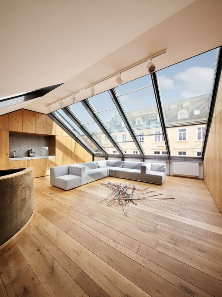 Giant roof windows placed on the ceiling - The Contemporary Design of a Three Story Building