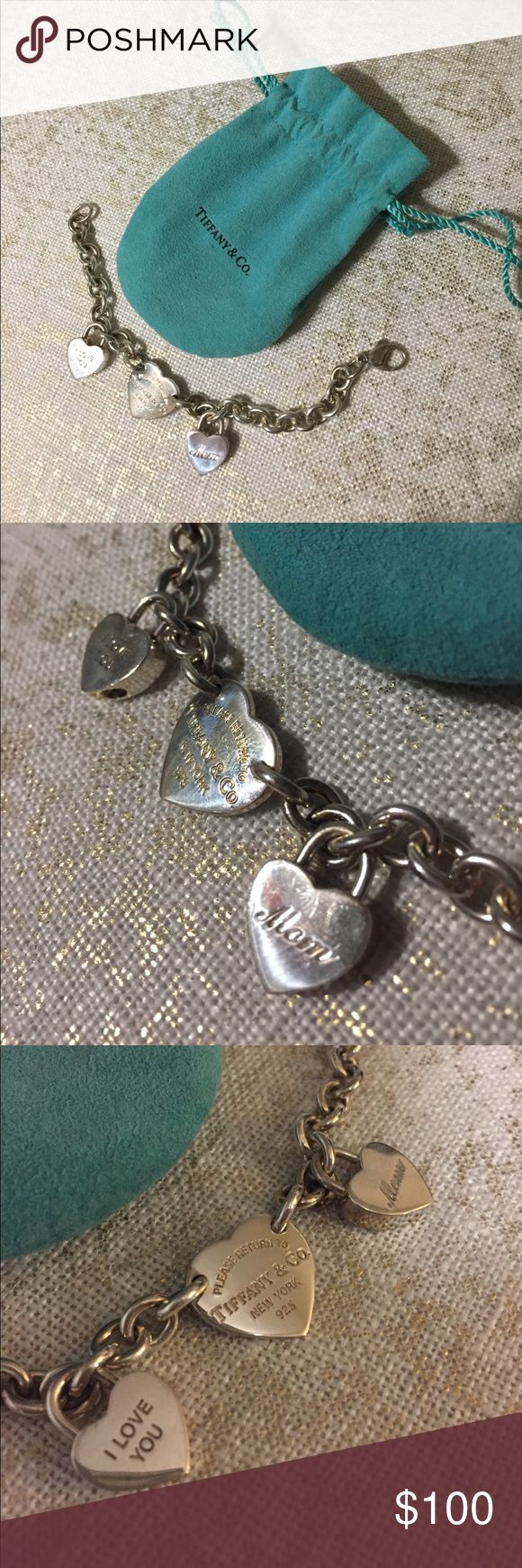 """Authentic Tiffany & Co. Charm Bracelet Sterling silver Return to Tiffany collection bracelet includes two matching heart charms """"I love you"""" and """"mom"""". Perfect gift! Comes with original bag shown. Tiffany & Co. Jewelry Bracelets"""