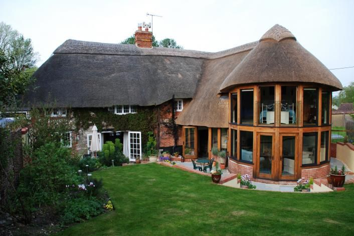 Oak framed extension to a thatched cottage.