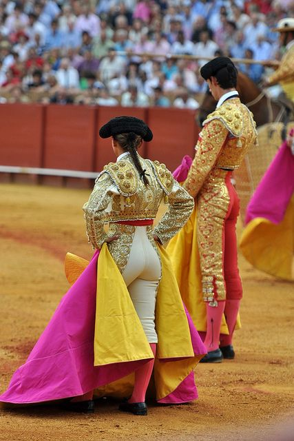 Bull fighting in Sevilla, Spain. This is not only considered a sport, but an art form. The best bull fighters are like rock stars to the Spanish people