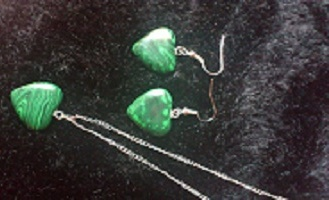 Gorgeous Malachite Heart Necklace and Earring Set....  Malachite balances mood swings and heals cramps.Boosts the immune and nervous systems. Malachite lowers blood pressure, treats asthma, arthritis, epilepsy, fractures, swollen joints, growths, travel sickness, vertigo, tumors, the optic nerve, pancreas, spleen and the parathyroid.Malachite stimulates the liver to release toxins.    Only $24.00..Include Postage World Wide!    Click here:  http://www.touchedbytheloveofangels.com/shop