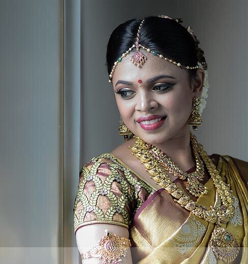 South Indian bride.Gold Indian bridal jewelry.Temple jewelry. Jhumkis. Gold silk kanchipuram sari.Braid with fresh flowers. Tamil bride. Telugu bride. Kannada bride. Hindu bride. Malayalee bride.Kerala bride.South Indian wedding