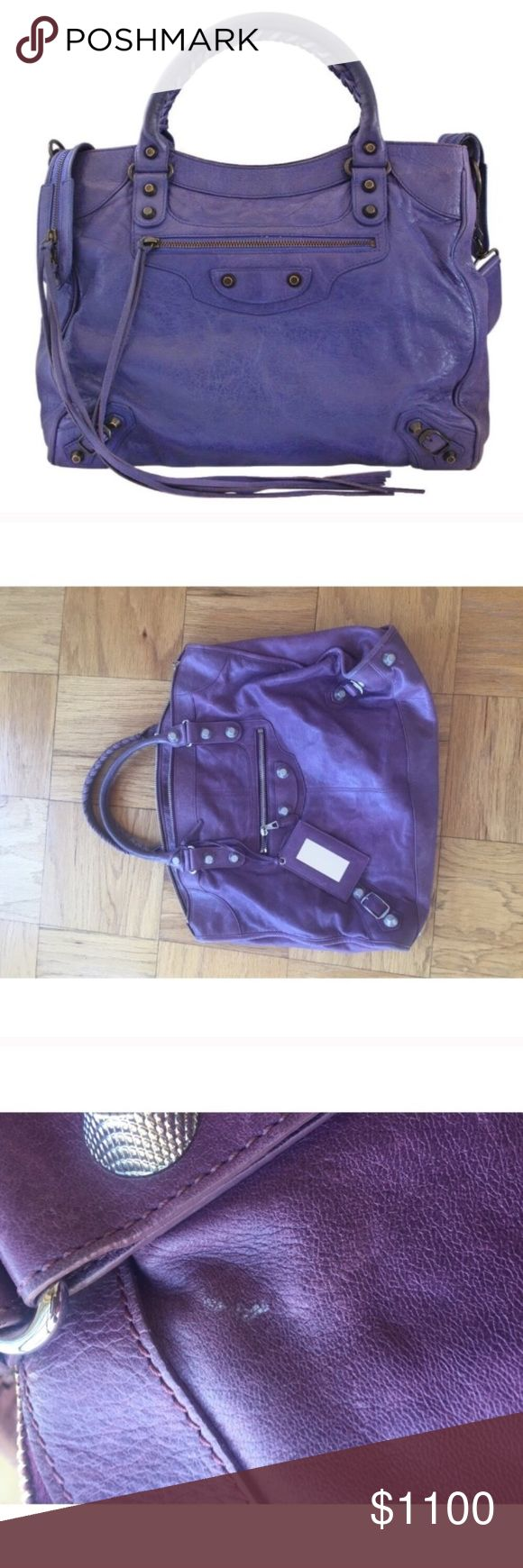 "BALENCIAGA Arena Giant City Purple Handbag This bag has exterior scuffs and some marks. The interior has some pet hair in the inside. Some scratches on the leather. Leather aging and some discoloration. It comes with a mirror. This bag is in excellent condition. This bag measures about 14"" in H and about 18.5"" W Balenciaga Bags Shoulder Bags"