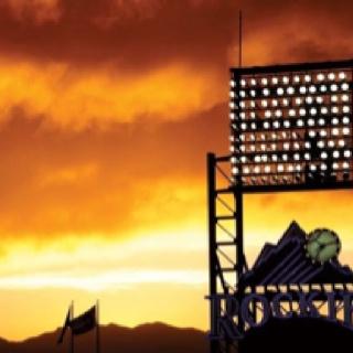 Colorado Rockies baseball at sunset.
