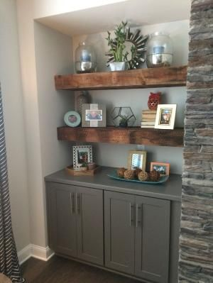 Our beautiful reclaimed wood floating shelves. Flanking fireplace with grey base cabinets located in family room. by molly