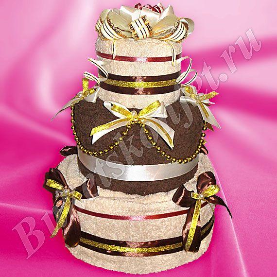 Торт из полотенец  Состав: 4 полотенца 100*150 см, 70*140 см (2 шт.), 50*90см.  Высота: 39 см.  В упаковке - 71 см.  Цена: 2 200 руб.
