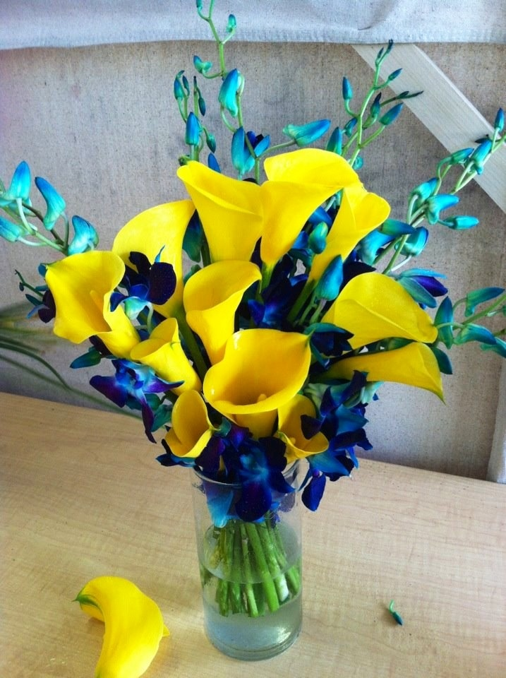 Yellow Callas and blue orchids are a beautiful combination for any wedding!  Created by Simple Elegant Weddings