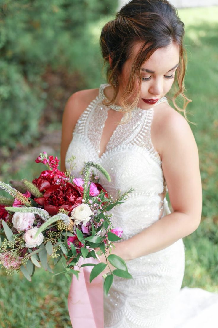Bride and bouquet from a berry hued wedding inspiration