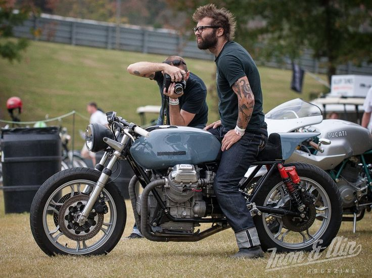 Moto Guzzi from Ace Corner at Barber Motorsports Park Vintage Festival. Even though he's not riding, rest assured those are kevlar reinforced Maple Motorcycle Jeans he's wearing.
