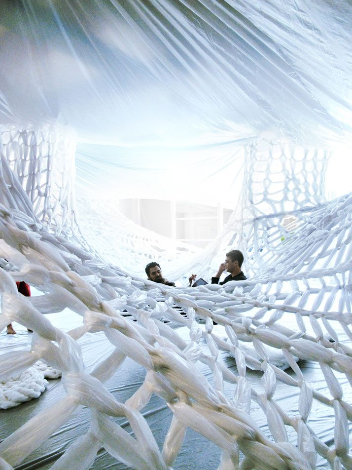 Gallery installation made from 80,000 square feet of plastic sheeting that has been sliced, loomed, woven, stapled, taped and tied to provide a climbable and malleable surface in the 4,500 square feet gallery space.