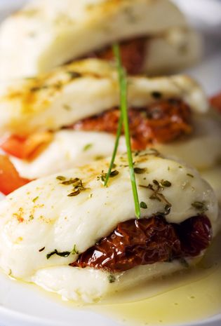 Baked Cyprus Haloumi Cheese with sundried tomato, oregano & chives