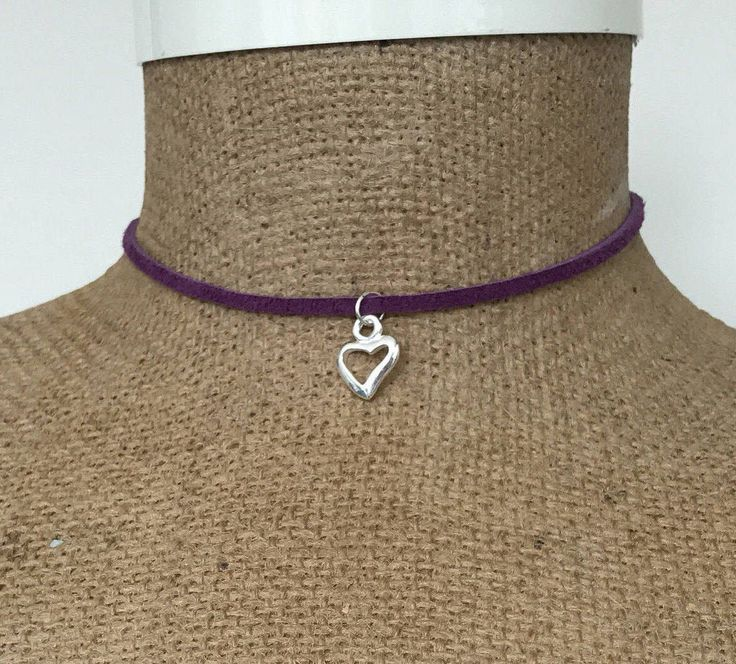 A personal favorite from my Etsy shop https://www.etsy.com/ca/listing/533550631/purple-and-silver-wrap-heart-charm-tie