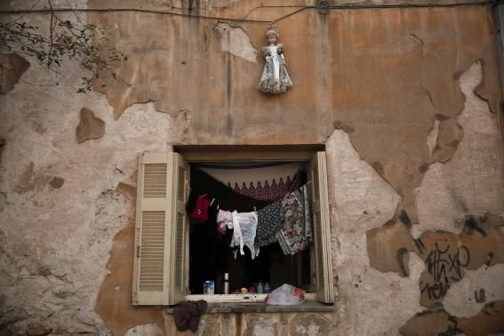 A doll hangs over a window of an apartment at the ''Prosfygika'' complex in #Athens #Greece #Refugees