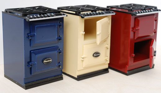 Small blue/red/beige AGA cooker with two opening doors and gas hob. This miniature is the best cooker for the kitchen of your dollhouse. It has an old style, just like Aga wood stoves. But it can be modern, You can select the color you would want, pink, aqua blue, blue marine, red, and so on. Size: High: 8 cm (3,15 in), Width: 5,5 cm (2,17 in), Depth: 5,2 cm (2,05 in)