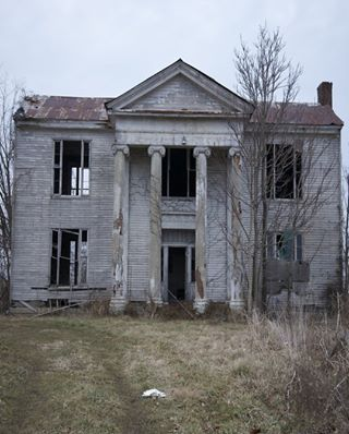 I always wonder what the story is behind old abandoned houses. This had to have been a nice house back when it was first built. I just start thinking about the families that lived there and wonder why someone eventually just let the house go to ruin :(
