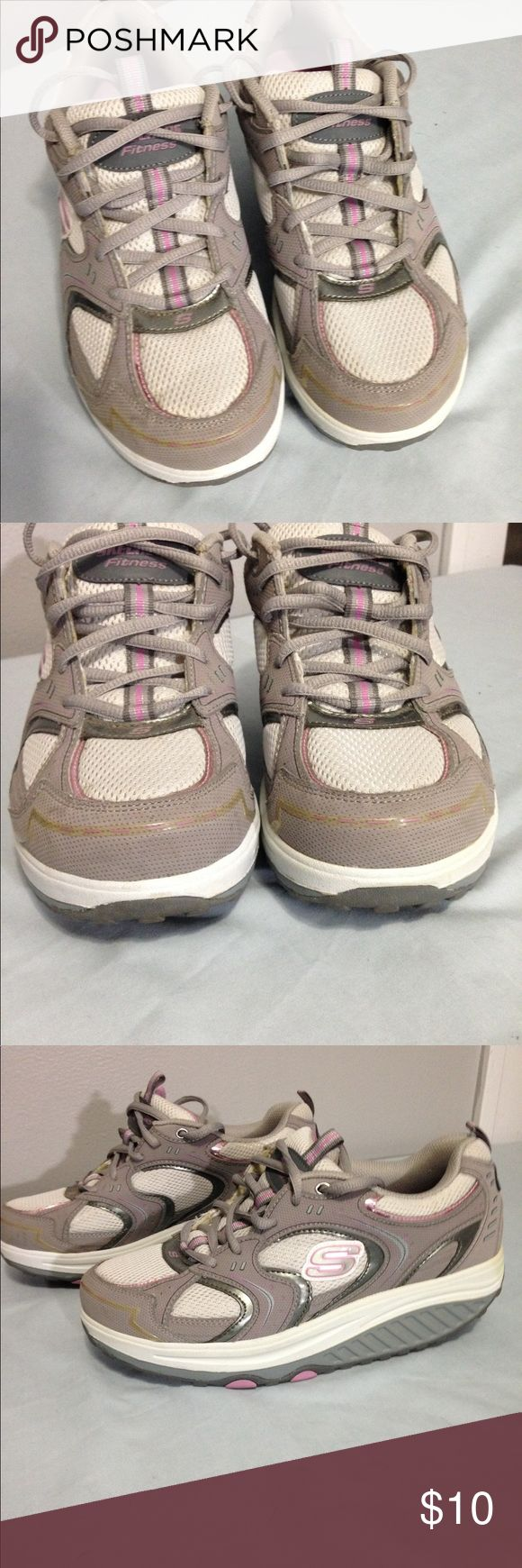 Sketchers Shape up athletic shoes Lovely gray and pick Sketcher Shape Up's have been gently used. The heal is firm and not broken down. The Shape of the sole is intact and not broken down. Upper is free or wear or stains. White part of sole appears to have a light grass stain on heals. Clean and ready to wear. Skechers Shoes Athletic Shoes