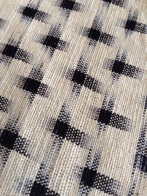 Handloomed white and black cross cotton Ikat fabric by Carol Ziogas and Thomas of California-based kimonomomo. $11/half yard. via Etsy