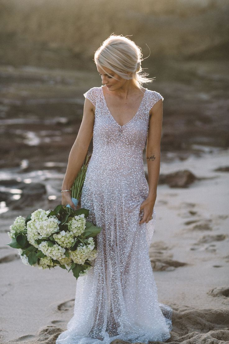Anna Campbell Sydney Dress | Hand-sequinned wedding dress | Embellished sparkly bridal gown  with capped sleeve and low back detail. #vintagebride #vintageweddingdress #sequindress #sparklyweddingdress #beadedweddingdres #modernbride #coolbride #bridalhair #chicbridePHOTOS: Vanessa NorrisPhotographyCONCEPT & STYLING: TOAST WeddingsGOWN: Anna Campbell BridalMUA & HAIR: Makeup by Sophie KnoxFLORIST: Pretty Street FlowerJEWELLERY: Marlene Miller AntiquesSUIT: Mickey Blue