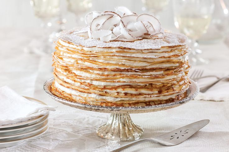 must try coconut crepe cake; rich, perfect crepe batter infused with heavy cream, coconut milk, extract and melted butter for the best recipe; filled with a whipped creme fraiche cream cheese cream infused with cream of coconut and sweetened with powder sugar