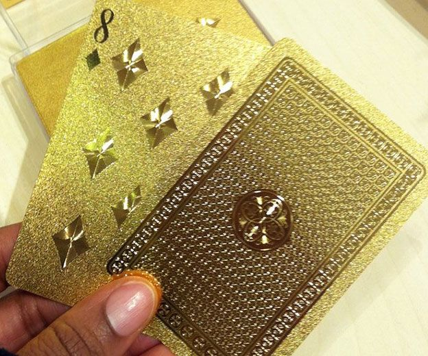 Up the ante without sacrificing a single chip next time you deal a game with the gold playing cards. This luxurious deck of cards - fit for King Midas himself - come coated with a custom gold paint job that is perfect for a adding a little class to game night.