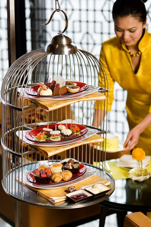Birdcage High Tea. what a great and unique idea for serving food alternative tray version. metallic and industrial touch with charme. for event catering or party