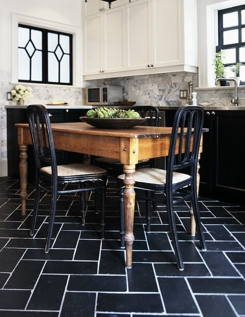 Antique table and chairs in a modern kitchen