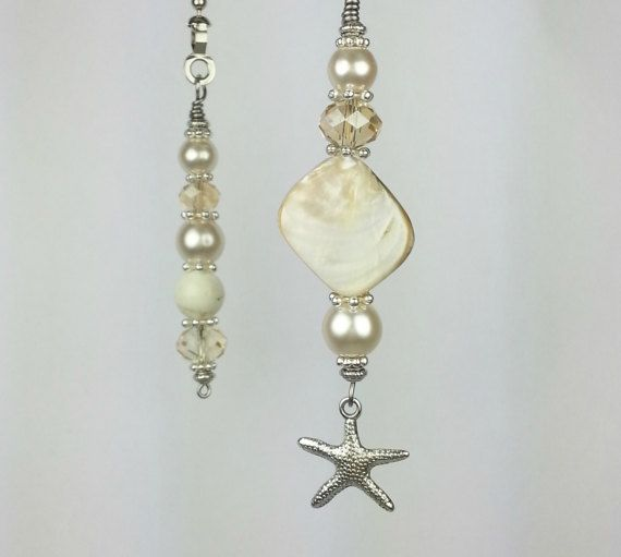 Ceiling fan pull chains. One for the light control and one for the speed control. Stainless steel wire, metal spacer beads, cream color glass faux pearl beads, champagne colored crystal, and a natural shell. Please note that every shell is unique and will vary from one in photo. I