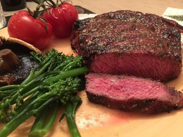 Monster rib-eye steak served with roasted vegetables