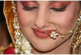 http://www.weddingsonline.in/blog/editors-pick-bridal-nose-ring-designs-we-love/ has more nose ring designs